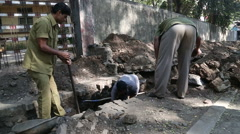 Men working at a street construction site in Mumbai. Stock Footage