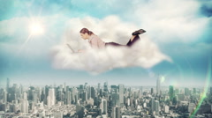 Businesswoman using laptop on a cloud Arkistovideo