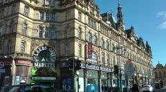 Victorian Architecture Traffic Street scene Leeds Kirkgate market Stock Footage