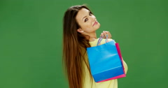 Attractive Young Woman Holding Coloured Shopping Bags - stock footage