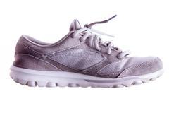 Lightly used grey sports shoe - stock photo