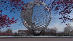 The Unisphere in Queens and Cherry Blossom Trees. World's Fair in Queens. Stock Footage