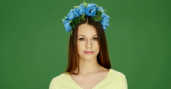 Attractive Young Woman Wearing Blue Floral Headdress - stock footage
