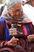 LEH, INDIA-MAY, 2012 - An unidentified tibetan old woman praying in a meeting Stock Photos