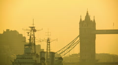 Morning traffic on the Tower Bridge, beautiful golden glow Stock Footage