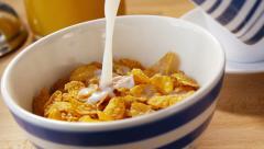 Pouring milk onto cornflakes, slow motion - stock footage