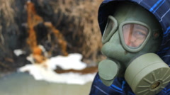 Man with mask near Chemical Liquid industrial Factory toxic waste in river Stock Footage