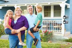 Portrait Of Family Outside Suburban House - stock photo