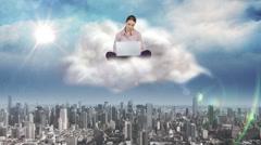 Businesswoman using laptop on cloud Arkistovideo