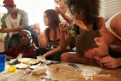 Gang Of Young People Taking Drugs - stock photo