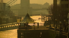 Early morning at the riverside of Thames, Tower Bridge in the background Stock Footage