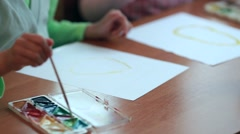 Children paint on paper Stock Footage