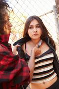 Girl Being Threatened With Knife By Female Gang Member - stock photo