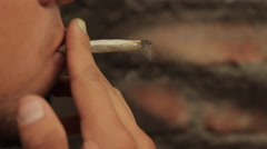 Young Male Smokes Joint, Teen, Youth, Marijuana, HD Close Up. Stock Footage