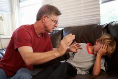 Father Being Physically Abusive Towards Son At Home Stock Photos