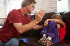 Father Being Physically Abusive Towards Daughter At Home Stock Photos
