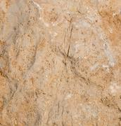 Uneven stone background texture with crack - stock photo
