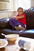 Unhappy Girl Sitting On Sofa At Home Stock Photos