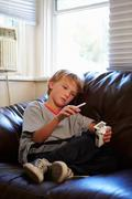 Boy Discovering Parent's Pack Of Cigarettes At Home Stock Photos