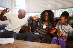 Physically Abusive Father With Family On Sofa - stock photo