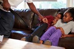 Father Being Physically Abusive Towards Children At Home - stock photo
