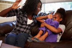 Mother Being Physically Abusive Towards Daughter At Home Stock Photos