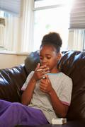 Girl Discovering Parent's Pack Of Cigarettes At Home Stock Photos