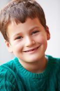 Indoor Portrait Of Boy Wearing Jumper Stock Photos