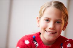Portrait Of Girl Wearing Christmas Jumper - stock photo