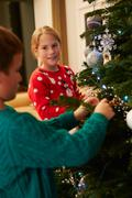 Children Decorating Christmas Tree At Home Stock Photos