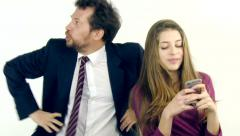 Female teenager driving father crazy with smart phone Stock Footage