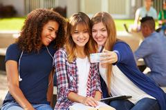 Female High School Students Taking Selfie On Campus Kuvituskuvat