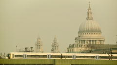 Commuter train passing by, St Paul's cathedral in the background - stock footage