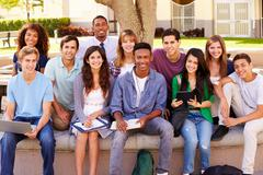 Portrait Of High School Students With Teacher On Campus - stock photo