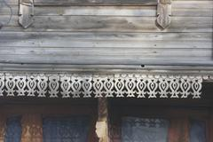 Stock Photo of Traditional wooden Russian carved platband of an old wooden house in the prov