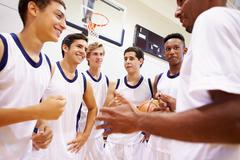 Male High School Basketball Team Having Team Talk With Coach Kuvituskuvat