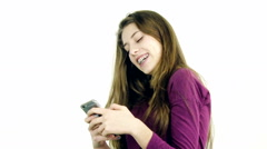Female teenager playing with cell phone making call Stock Footage