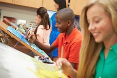 Male Pupil In High School Art Class Stock Photos
