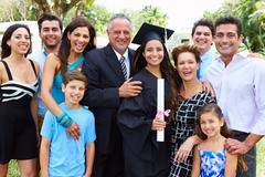 Hispanic Student And Family Celebrating Graduation Kuvituskuvat