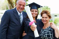 Hispanic Student And Parents Celebrate Graduation Stock Photos