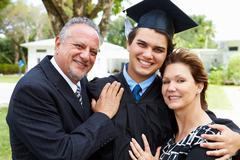 Hispanic Student And Parents Celebrate Graduation - stock photo