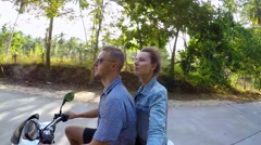 Happy Couple Driving Scooter Excited on Summer Holidays Stock Footage