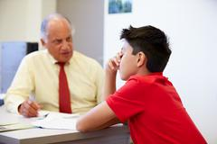 Male Student Talking To High School Counselor Stock Photos