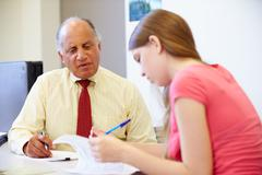 Female Student Talking To High School Counselor Stock Photos