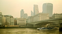 Boat passing by from the right, pan in the city of London Stock Footage