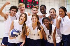 Portrait Of High School Volleyball Team Members With Coach Stock Photos