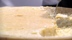 Chopping pieces of massive Parmesan cheese Stock Footage
