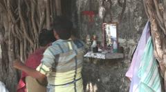 Men combing hair at the street hair salon in Mumbai. Stock Footage