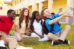 High School Students Taking Selfie With Digital Tablet - stock photo