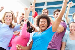 Audience Dancing At Outdoor Concert Performance - stock photo